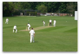 Dominic bowling against Guildford at the County Ground.